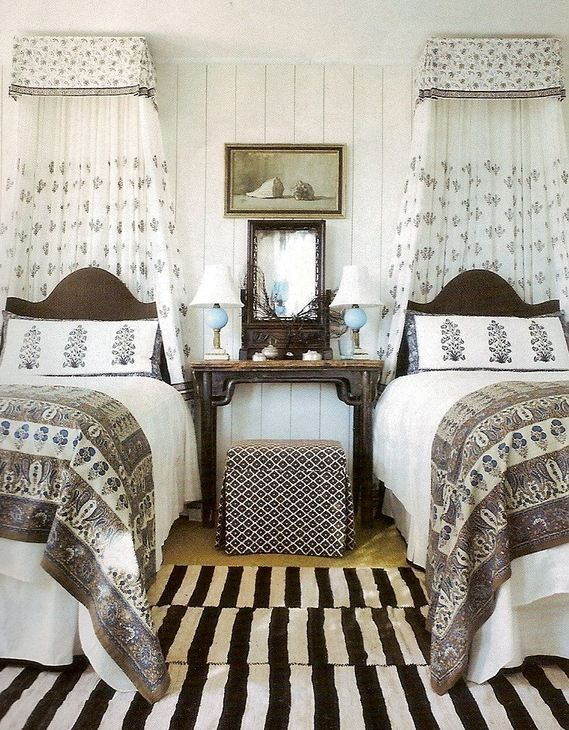 Boho beach bungalow guest room by Amelia Handegan, pair twin beds, striped rug, canopy bed, guest room ideas, paisley print, eclectic style