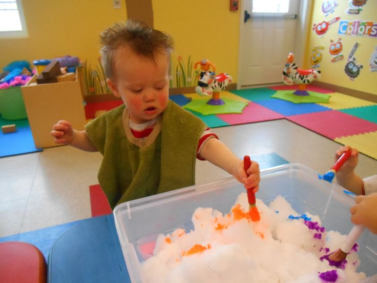 Painting the snow!  When it's too cold and snowy to go outside, bring the outside in!  The teachers in our toddler classroom gathered snow from outside and brought it in for the toddlers to explore.  To add to the experience the teachers gave the children a paint brush and let them make colored snow!