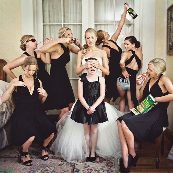 funny picture with the bridesmaids, flower girl, and bride. just may have to do this