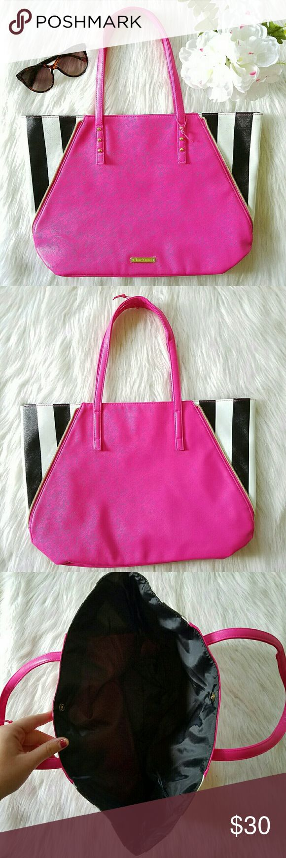 """Juicy Couture Pink Striped Tote Bag Juicy Couture brand. XL Tote / Shoulder Bag  18"""" W x 12.5"""" H x 3"""" D Perfect for the gym or the beach! Hot pink body with black and white stripes on each side. Accented with gold tone zipper trim.  Black satin interior lining. Top magnetic closure. Brand new! Never used! The tags were pulled off by accident. The protective film covering is still attached to the logo plate on the front. Juicy Couture Bags Totes"""