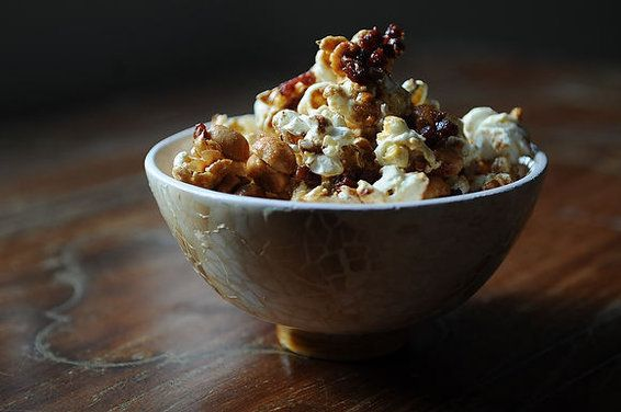 Tipsy Maple Corn: popcorn with butter, salty peanuts, sweet maple syrup, bacon and Jack Daniels.  Sweet, salty, butter, bacon and booze.  Does it get any better than that?!?