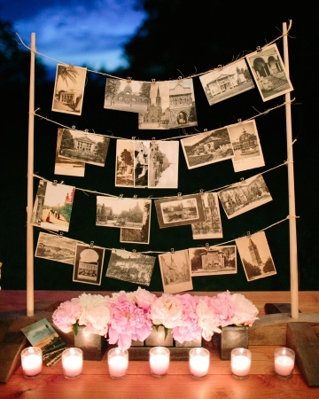 To celebrate their love of travel, this couple purchased vintage postcards and displayed them on a wooden stand
