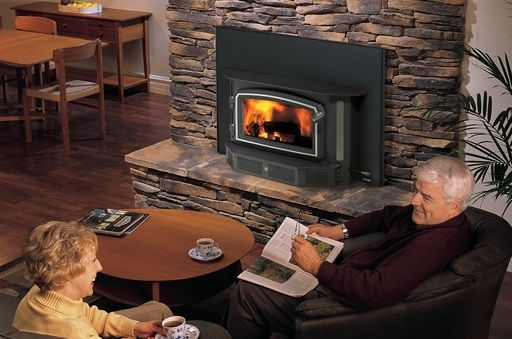 Home is where the hearth is! Beautiful wood fireplace insert.