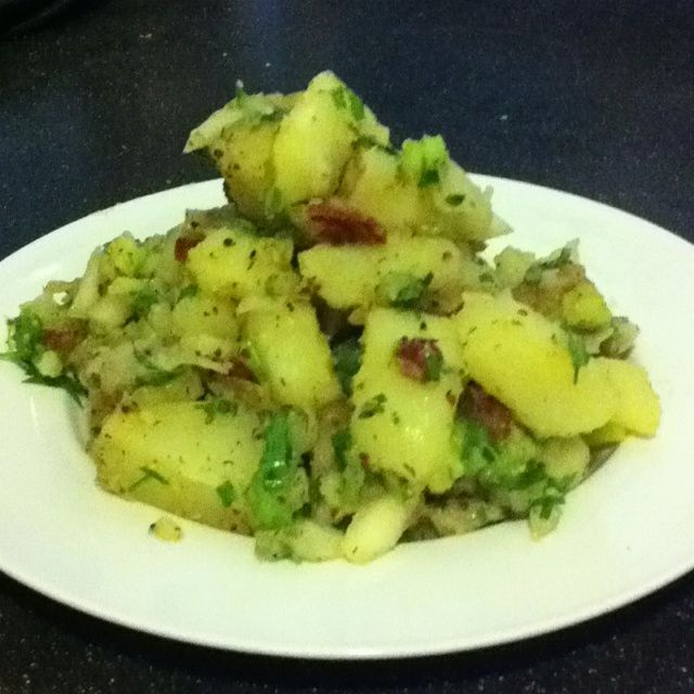 Bitchin Frenchie potato salad. Best potato salad Ive ever had! Used delishhh.coms recipe for base and added chipotle-spiced bacon, celery, chives, and diced onion. Mmmm!