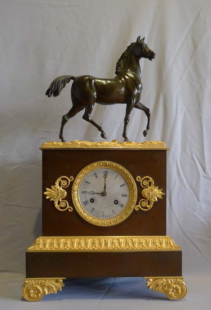 Antique French Charles X period patinated bronze and ormolu mantel clock of a stallion. -