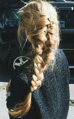 This thick blonde french braid is so gorgeous.