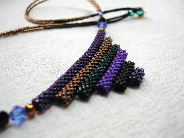 Geometric Blue Statement Necklace/ Triangle Tubular Peyote Necklace. $120,89, via Etsy.
