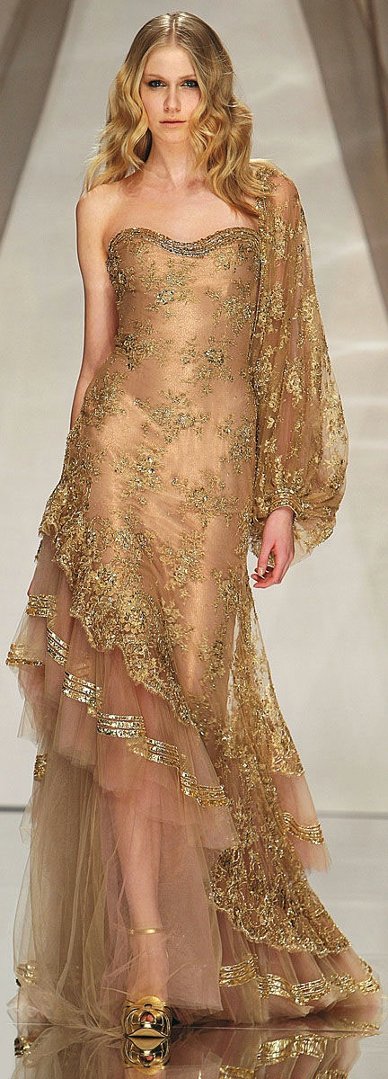 Abed Mahfouz.  I feel like the sleeve is awkward but the gown is gorgeous!