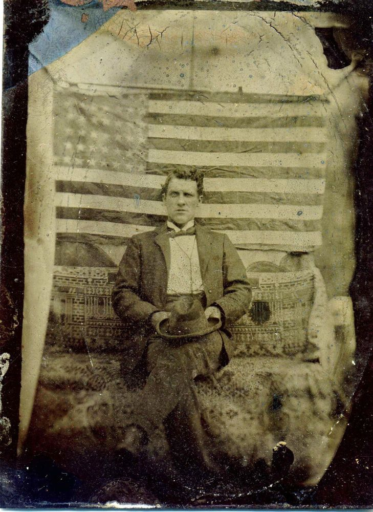 CIVIL WAR ERA TINTYPE SEATED MAN IN TENT WITH LARGE AMERICAN FLAG BEHIND HIM