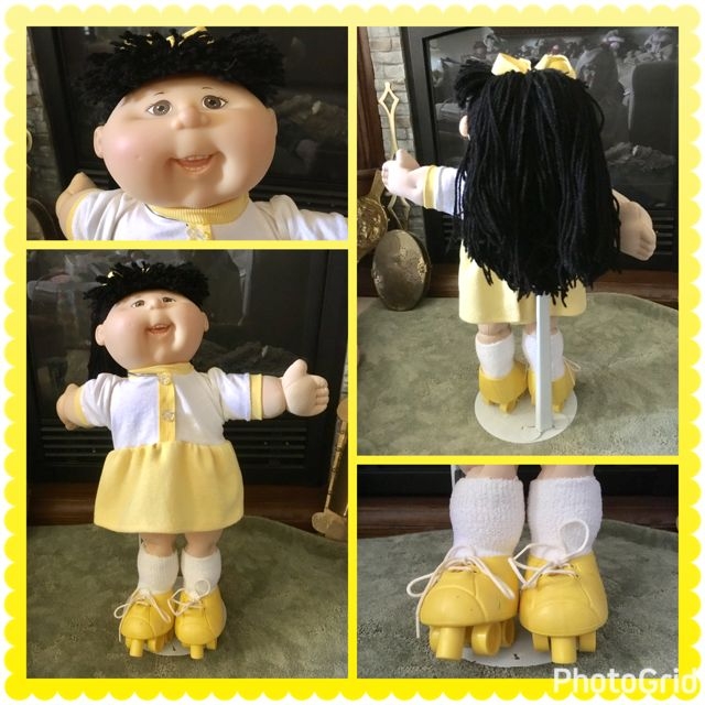 $30.00 This sporty brown eyed Cabbage Patch girl has long thick black hair styled in a ponytail. She has a big toothy smile. She is wearing a white and yellow dress and yellow rollerskates.