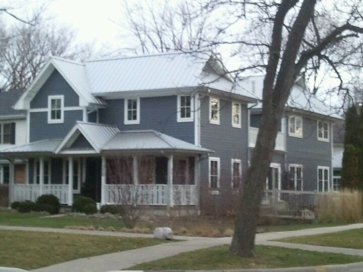 Silver Steel Roof And Blue Siding W White Trim House