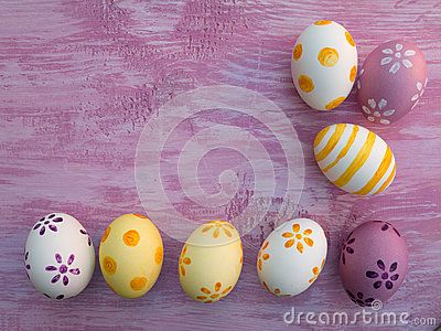 Yellow and violet Easter eggs on the violet board