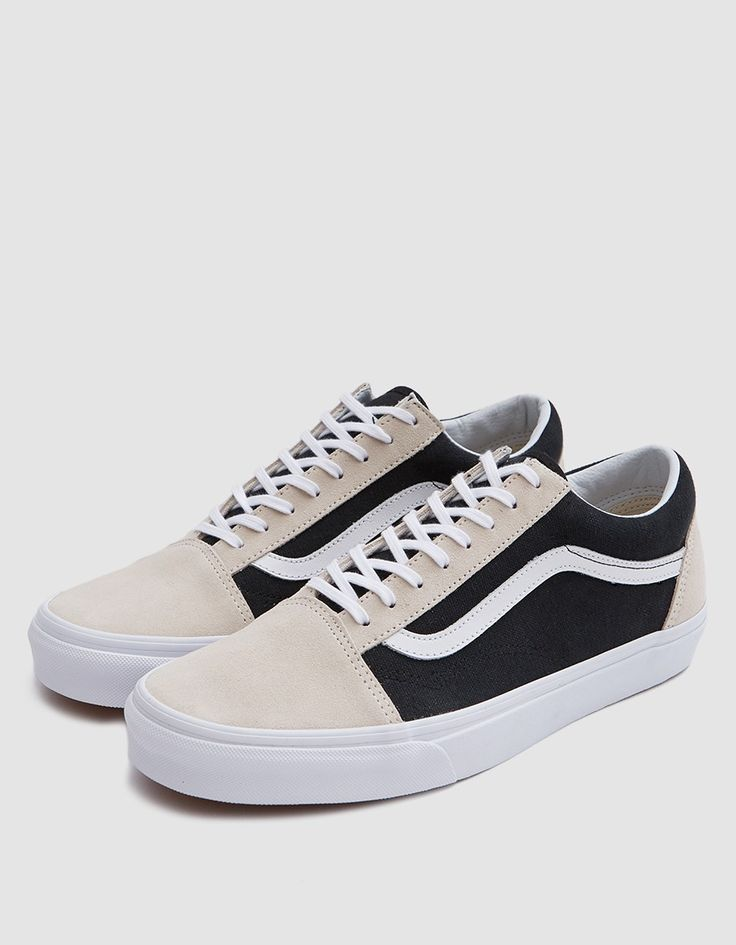 Old Skool from Vans in Birch and Black. Suede and canvas upper. Lace-up front with flat woven laces. Lightly padded collar. Iconic side stripe at lateral and medial sides. Tonal stitching. Signature rubber waffle outsole. • Leather and textile upper •