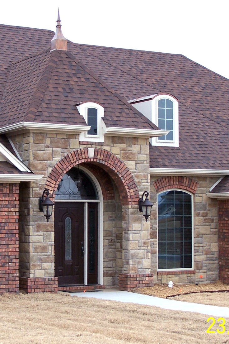 Welcome Home Entrance With Brick Arch Topped With A