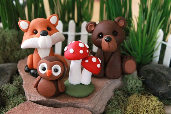 This listing is for one set of hand sculpted polymer clay forest animals. The base set includes: brown bear (approximately 2), fox (approximately 2), owl (approximately 1) and mushroom cluster (approximately 1). Add on options include raccoon (approximately 1.75) or deer (approximately 3) or choose all animals for a larger cake. *****If you would like any combination of the additional animals, please contact me and I will set up a special listing for you! Made from quality polymer clay and…
