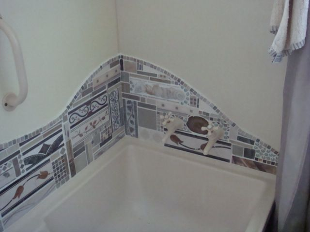 Tiling round the shub with odd tiles...was fun!!