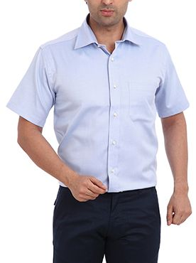 Here is another masterpiece from the house of Raymond for people who love to dress professionally. The formal shirt features a half sleeve design and a contemporary fit. It is made from pure cotton which provides you full comfort even after wearing for the whole day. This medium blue colored shirt looks very professional when you wear it with a dark colored trouser and matching formal shoes. You can wear this to your work place with pride to make a strong fashion statement.