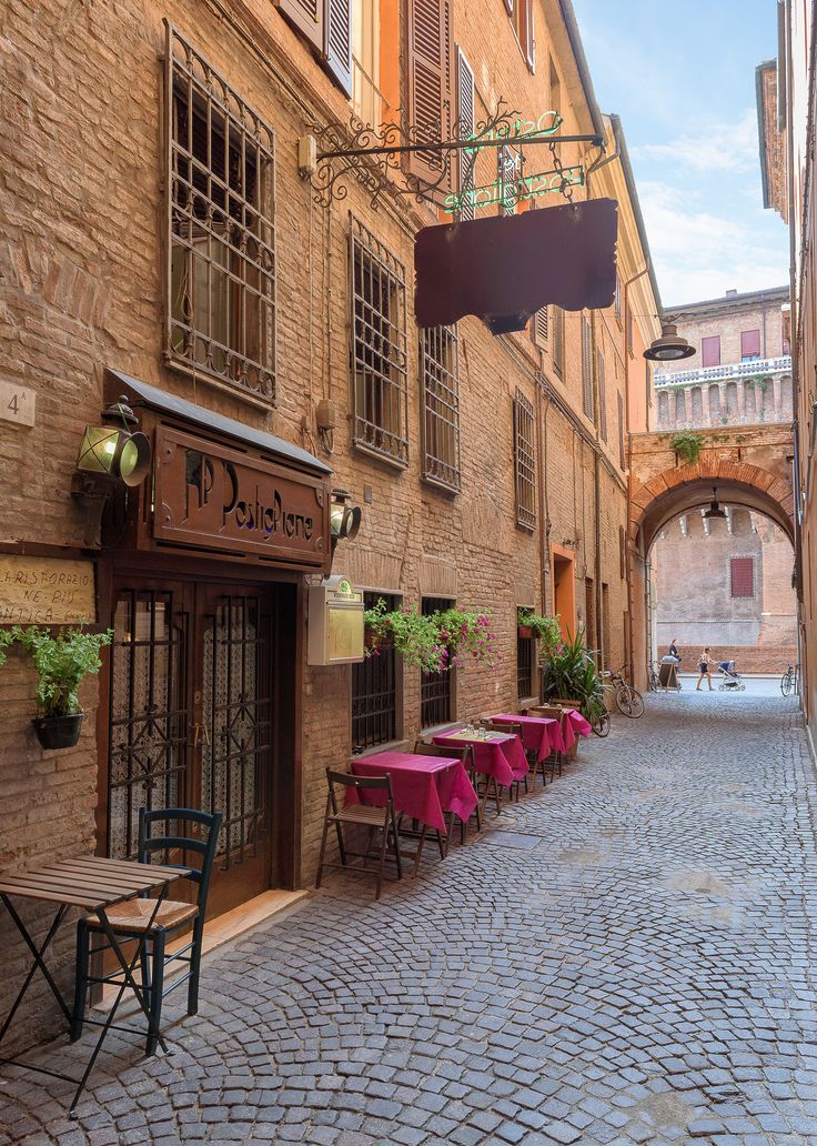 """Hidden Alley - This is a little street in the city center of Ferrara; it's called """"Vicolo Chiuso del Teatro"""" (Closed Alley of the Theather). On the background there is the Estense Castle and on the left there is a wine shop (""""enoteca"""" in italian)"""