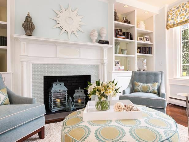 Natural Light Pours Into This Transitional Living Room Playing Up Its Soft Blue Walls Matching Chairs And A Fireplace With Bright White Mantel