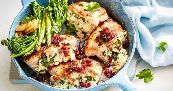Cranberry sauce adds a touch of sweetness to these juicy, pork steaks made with a delicious spinach and ricotta stuffing.