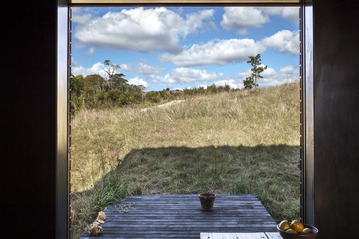 The view from the interior of one of the cabins onto its small deck. Photograph by Darryl Ward.