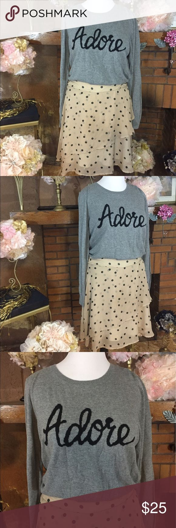 "Maurices tan and black polka dot skirt outfit Maurices tan and black polka dot skirt. Chiffon with ruffle size XL. Approx measurements are 35-44 inch elastic waist and 20 inches long. 100 % Polyester fully lined. Old Navy ""Adore"" sweater gray and black size XL. Lightweight and stretchy. Previously owned but in good condition free of stains and defects. Please check out all pictures. Read full description of the items. Ask me any questions. Maurices  Skirts Mini"