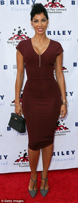 Stunner: Eddie Murphy's former wife Nicole Mitchell Murphy, 48, wowed in a figure-hugging burgundy dress with a zipper down the back that clung to every curve