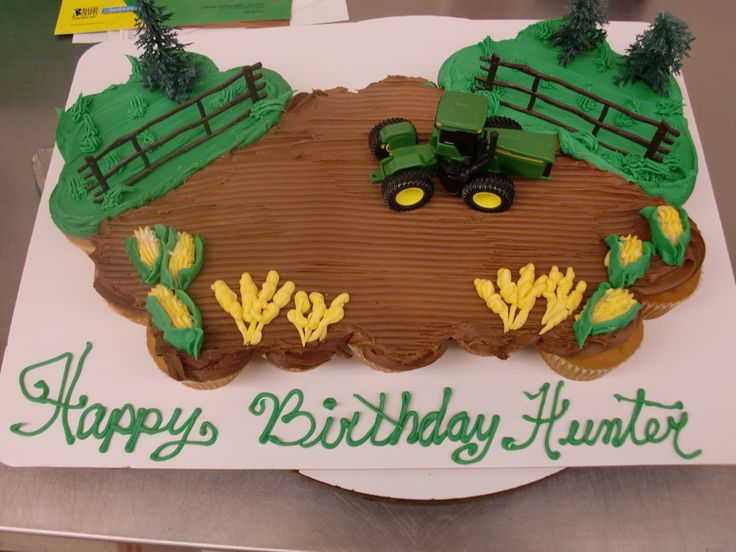 Here's a cute and easy cupcake-cake idea. Cover a group of cupcakes in brown icing for dirt and decorate with a toy tractor so it looks like a farmer's field.
