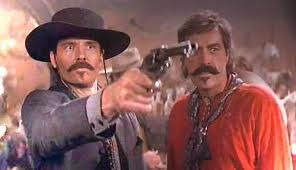 Tombstone - Michael Biehn as Johnny Ringo and Powers Booth as Curly Bill Brocius