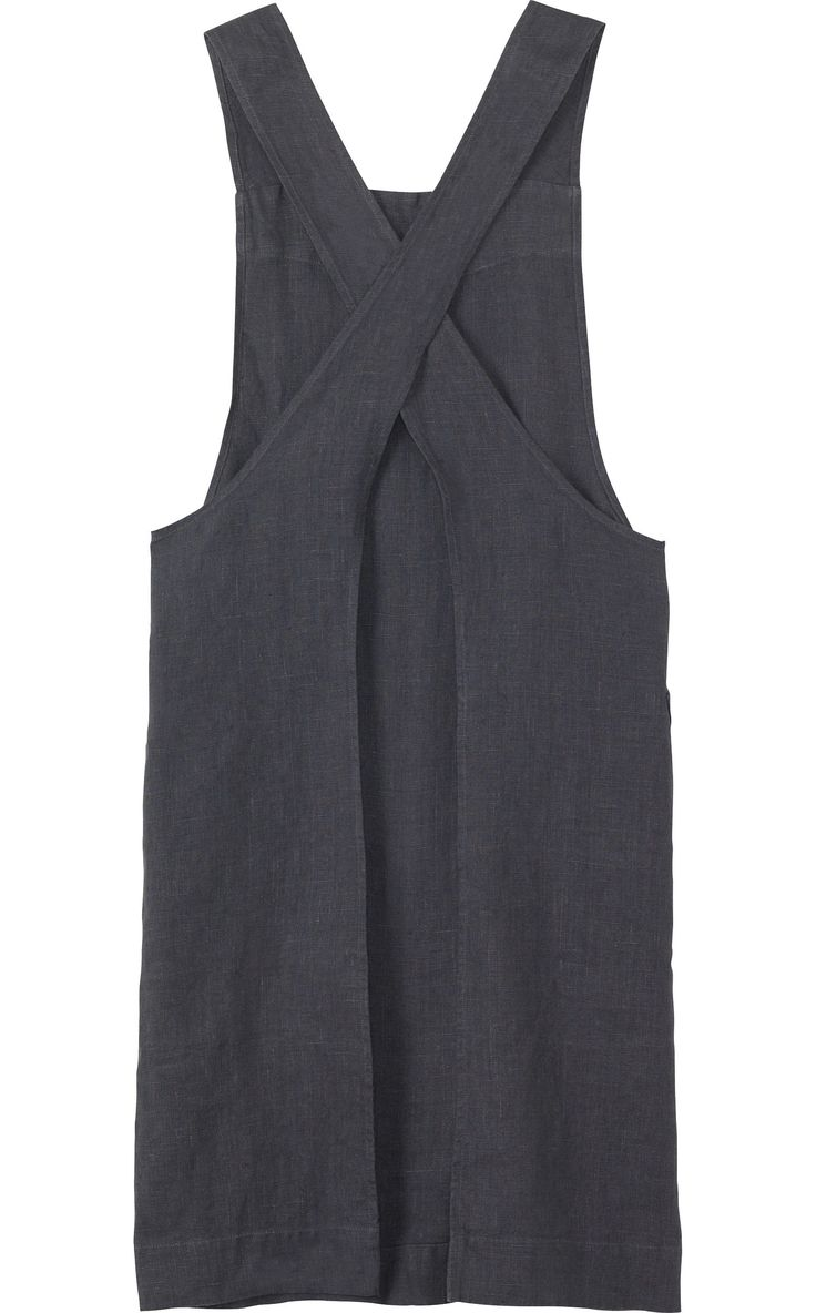 Apron in good quality, slubby, robust washed linen from the Baltic. Two, wide straps cross over at the back. Two patch pockets.