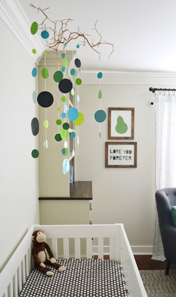 Great post - I especially love this mobile!!  Door Decisions, Art Updates,  One Big Belly | Young House Love