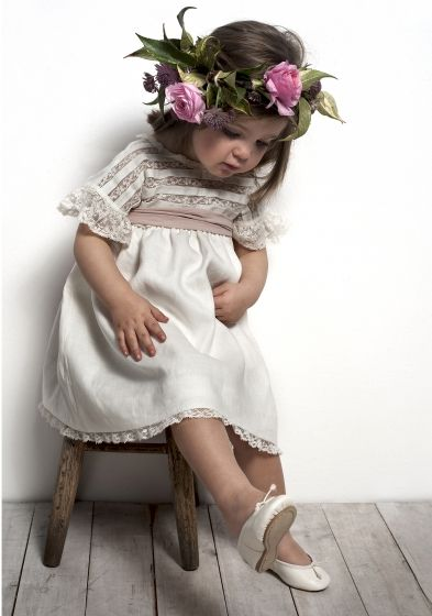 adorable flower girl in lace embellished dress with an amazing crown
