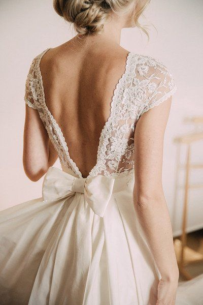 Romantic wedding dress idea – deep v-back wedding dress with lace details and bi…