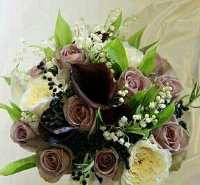 Wedding Bouquet Arranged With: White English Garden Roses, White Lily Of The Valley, Amnesia Roses, Aubergine Calla Lilies, Dark Blue Privet Berries, Green Lily Of The Valley Foliage