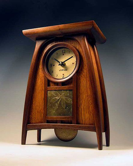 Cat's Eye Craftsman - Scottish Inspiration by the Art Nouveau style of the Glasgow School of Art.  Clock is walnut and oak with a brass dragonfly accent.