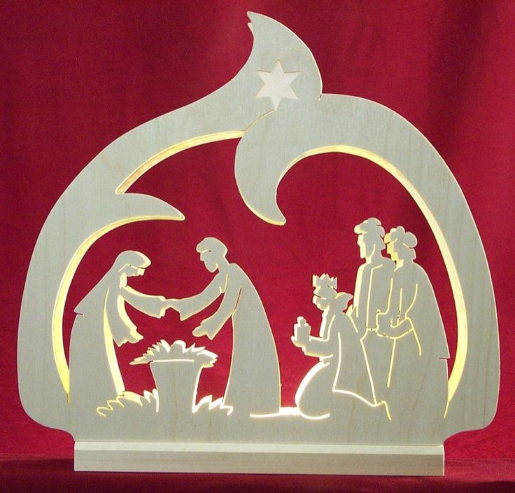 Lovely LED Candle arch with a nativity scene, by Michael Müller. Traditional German Christmas decoration.