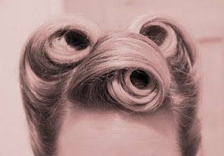 Forties victory rolls.  So cleanly rolled- no strays at all!