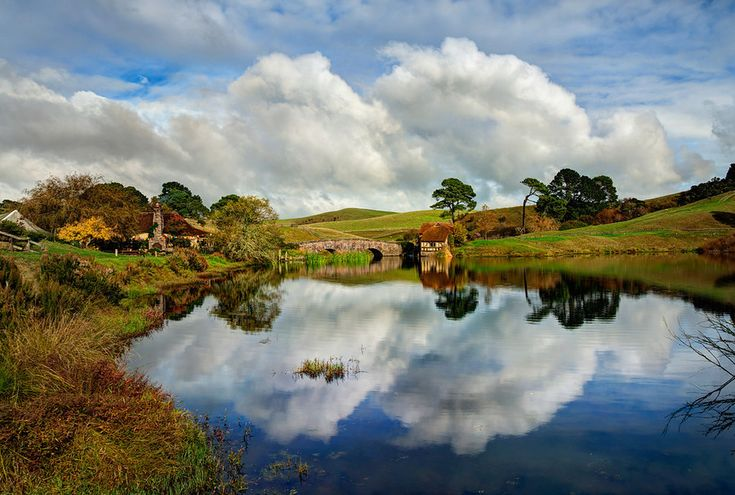 There seem to be epic clouds over Hobbiton almost all the time! So amazing and wonderful, isn't it, the way the accumulate and float around. I've been here to Hobbiton probably 9 times now, and I always get interesting clouds at various puffy-levels. This one is maximum puff! - Matamata, New Zealand - Photo from #treyratcliff Trey Ratcliff at http://www.StuckInCustoms.com