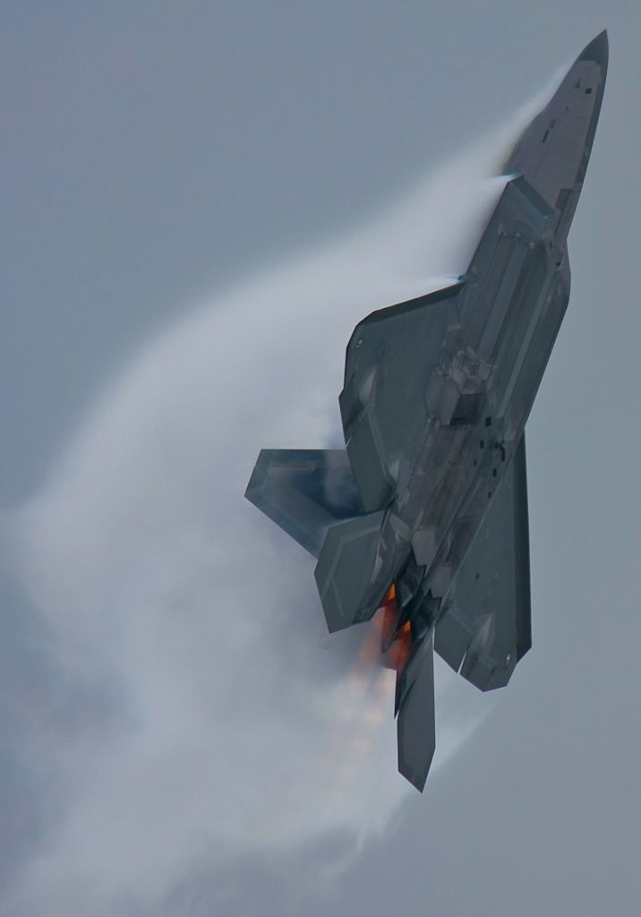 F-22 Raptor - Note the Vector Paddle Angle in Afterburner to The Angle of the Raptor. That Vectored Thrust enables Extreme Angle of Attack!