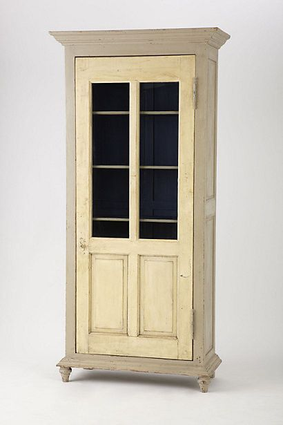 old door repurposed as cabinet door... looks like a bookcase with the door attached. Such a great idea.