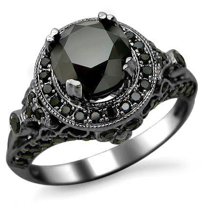 Gothic engagement ring, black diamond, black gold ring   From Blog: 25 Black Diamond Engagement Rings via InkedWeddings.com