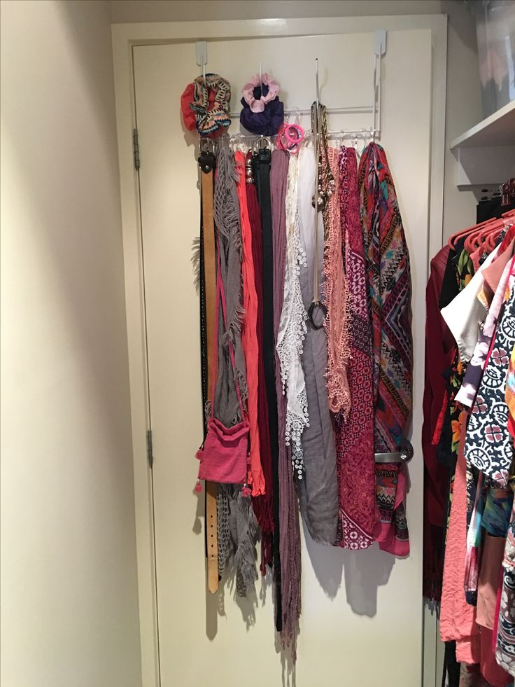 Over the door hanger. Used clear shower rings to hang scarves onto base of hanger. Belts and Jewellery hung on hooks.