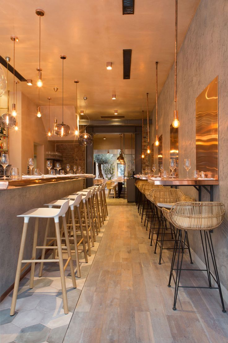 The Bandol Restaurant copper tables along the