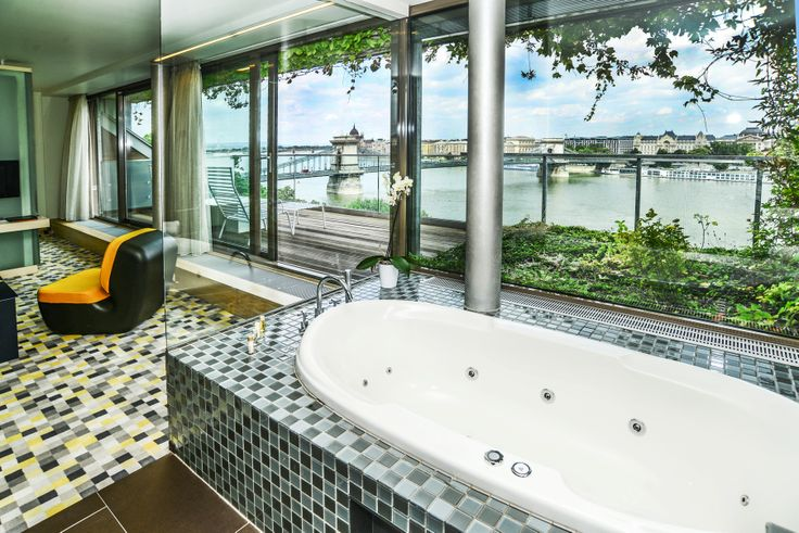 Budapest sightseeing from a jacuzzi bathtub at Lanchid 19 design hotel.