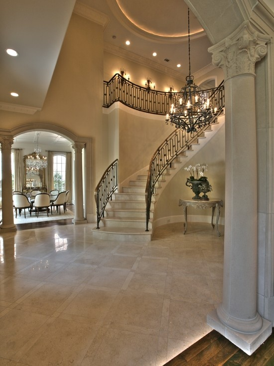 Elegant French style Foyer with cast stone columned & arched openings...