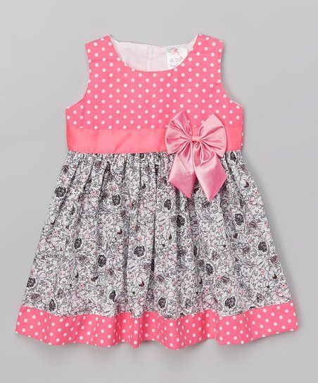 This cool and comfy dress boasts a dainty bow and button-up back. A coordinating tie allows you to adjust the fit for added comfort.