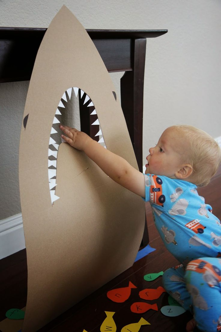 Feed the Shark Game- adapt using bean bags instead of lettered fish.  You can adapt the game for different ages by feeding the shark different colors, shapes, letter shapes, and letter sounds.  The possibilities are endless!