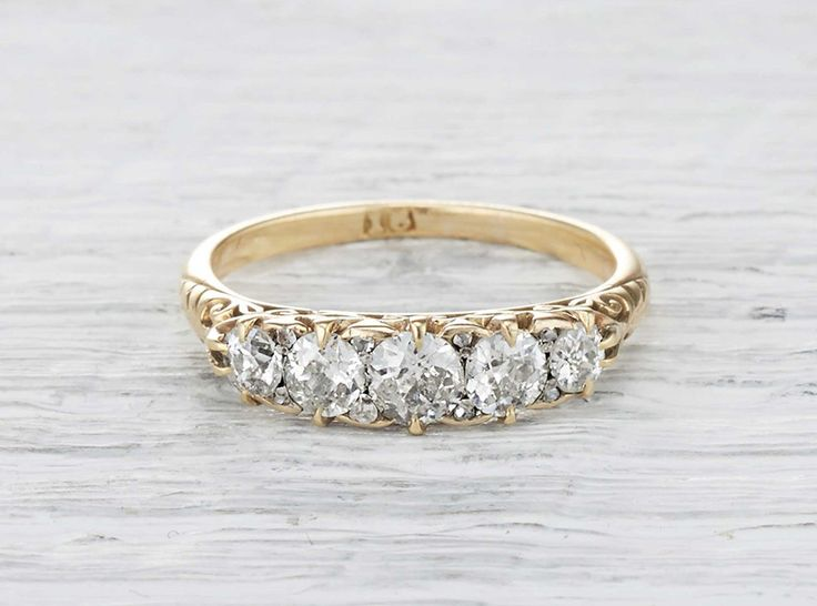 Vintage Victorian carved half hoop band made in 18k yellow gold and set with five old European cut diamonds weighing approximately 1.50 carats total. Circa 1880.