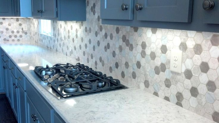Silestone Helix paired with a hexagon backsplash.