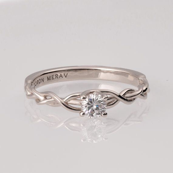 Hey, I found this really awesome Etsy listing at https://www.etsy.com/ca/listing/247110080/braided-engagement-ring-white-gold-and